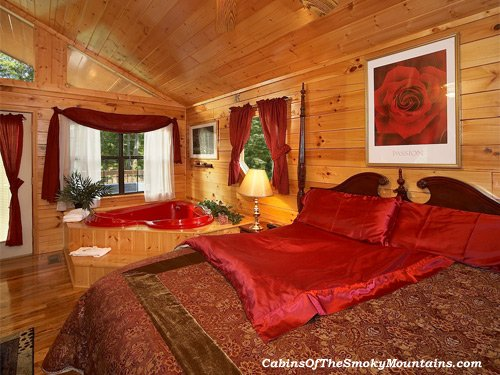 Romantic Gatlinburg Honeymoon Cabins feature red heart-shaped jacuzzis for two, outdoor hot tubs on 'very' private decks, fireplaces, kitchens in Gatlinburg, TN.